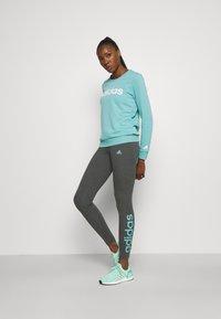 adidas Performance - LOUNGEWEAR ESSENTIALS HIGH-WAISTED LOGO LEGGINGS - Tights - dark grey heather/mint ton - 1