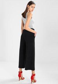 mbyM - MOULAN - Trousers - black - 2