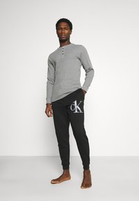 Calvin Klein Underwear - ONE RAW JOGGER - Pyjama bottoms - black - 1