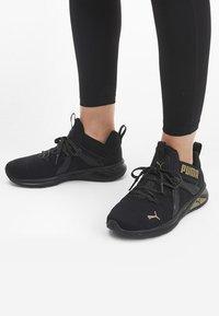 Puma - Trainers - black/gold - 0