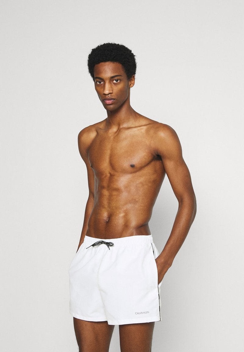 Calvin Klein Swimwear - LOGO TIES RUNNER PACKABLE - Badeshorts - white
