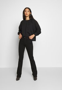 Levi's® - 725 HIGH RISE BOOTCUT - Jeansy Bootcut - black sheep - 1