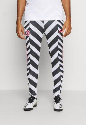 MANCHESTER UNITED  - Teplákové kalhoty - white/black