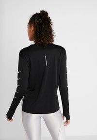 Nike Performance - Long sleeved top - black - 2