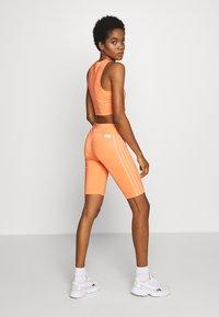 adidas Originals - CYCLING - Shorts - semi coral - 2