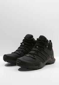 adidas Performance - TERREX SWIFT R2 MID GTX GORETEX HIKING SHOES - Hiking shoes - core black - 2