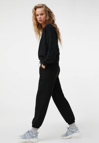 OYSHO - Tracksuit bottoms - black - 3