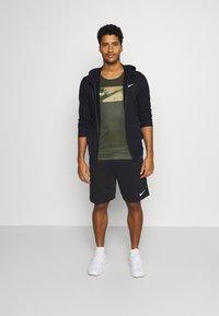 Nike Performance - Sports shirt - olive - 1