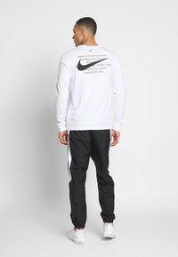 Nike Sportswear - PANT - Tracksuit bottoms - black/white - 2