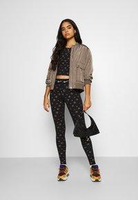 Nike Sportswear - TANK - Top - black/metallic gold - 1