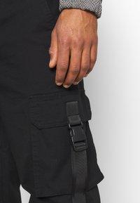 Topman - WEBBING - Cargo trousers - black - 3