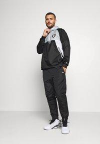 New Era - NFL OAKLAND RAIDERS RIPSTOP - Club wear - black - 1