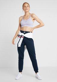 South Beach - REFLECTIVE TOGGLE - Pantalones deportivos - navy - 1