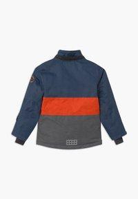 LEGO Wear - JOSHUA UNISEX - Winter jacket - light blue - 2