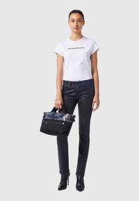 Diesel - D-LYLA - Slim fit jeans - black/dark grey - 1