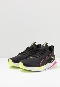 Puma - SOFTRIDE RIFT TECH - Zapatillas de running neutras - black/fizzy yellow - 2