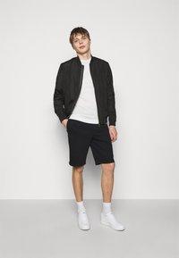 Emporio Armani - BERMUDA - Shorts - black - 1