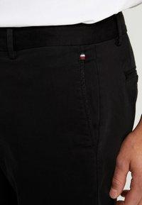 Tommy Hilfiger - DENTON - Trousers - black - 3