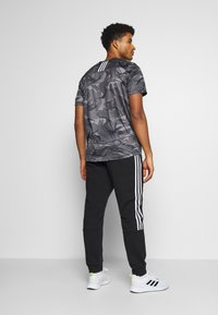 adidas Performance - CUT - Spodnie treningowe - black/white - 2