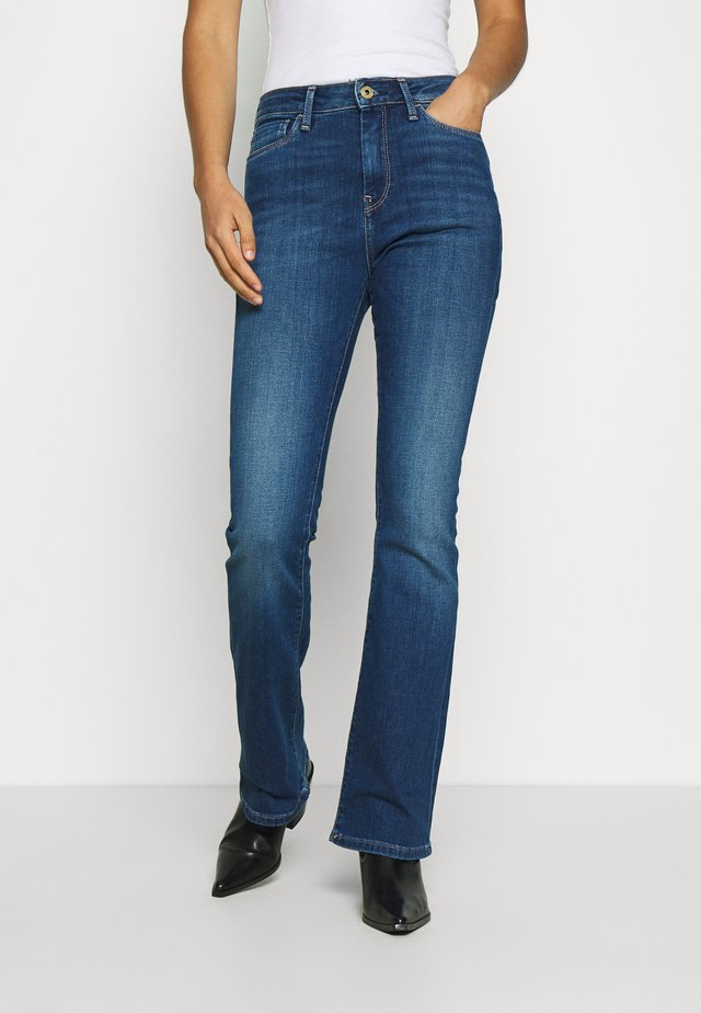 DION  - Flared jeans - dark-blue denim