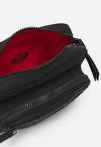 DAY ET - EFFECT - Across body bag - black - 2