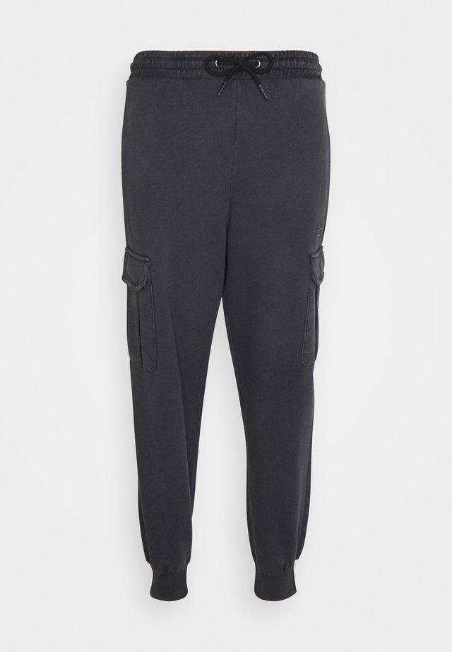 SMALL SIGNATURE WASHED UNISEX - Cargo trousers - black