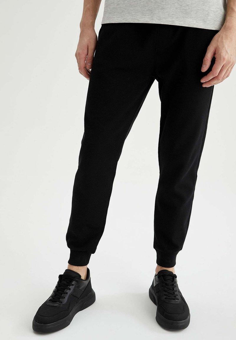 DeFacto - Tracksuit bottoms - black
