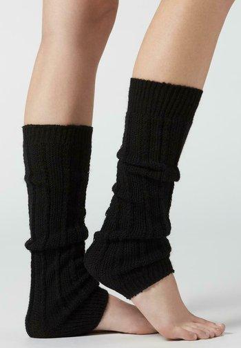 MUSTER - Leg warmers - black vertical knit