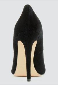 Evita - High heels - black - 1