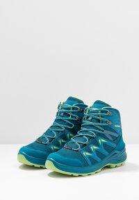 Lowa - INNOX PRO GTX MID JUNIOR UNISEX - Hiking shoes - türkis/mint - 3
