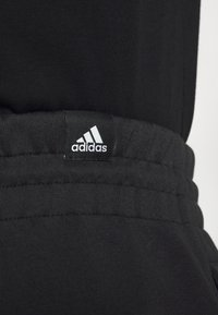 adidas Performance - URBAN PANT - Tracksuit bottoms - black/neon green - 6