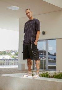 adidas Originals - ADILETTE SLIP-ON-DESIGN SHOES - Badesandaler - footwear white/yellow/core black - 6