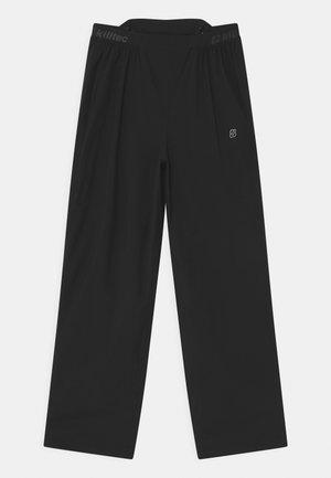 RUR UNISEX - Rain trousers - schwarz