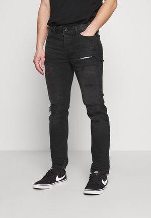 RIP AND REPAIR - Slim fit jeans - black