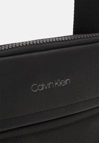 Calvin Klein - FLATPACK UNISEX - Across body bag - black - 3