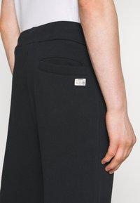 Diesel - UMLB-PETER-BG TROUSERS - Pantaloni sportivi - black - 5