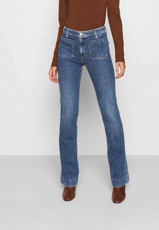 Jeans a zampa - true vintage
