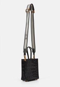 N°21 - MICRO - Across body bag - black - 1