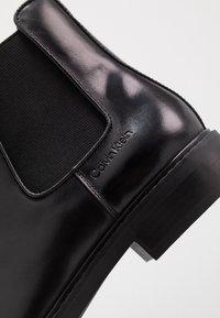 Calvin Klein - FINTAN CHELSEA - Classic ankle boots - black - 5