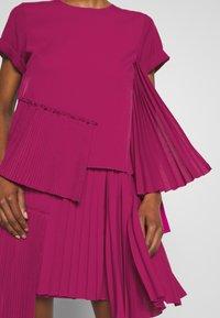N°21 - Korte jurk - pink - 6