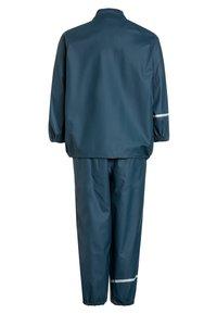 CeLaVi - RAINWEAR SUIT BASIC SET WITH FLEECE LINING - Rain trousers - iceblue - 2