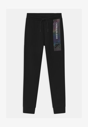 REFLECTIVE LOGO SLIM FIT UNISEX - Pantalon de survêtement - black