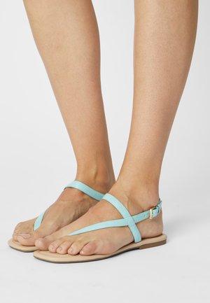 HOLTHUIS - T-bar sandals - light green