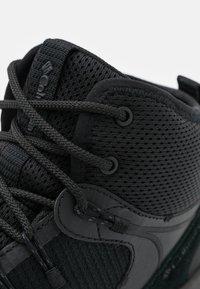 Columbia - TRAILSTORM MID WATERPROOF - Hiking shoes - black/dark grey - 5