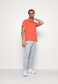 Under Armour - ROCK TRACK PANT - Tracksuit bottoms - mod gray - 1