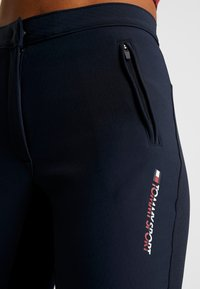 Tommy Sport - TRAINING TAPERED PANT REFLECTIVE - Tracksuit bottoms - blue - 4