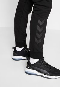 Hummel - HMLISAM REGULAR - Tracksuit bottoms - black - 3