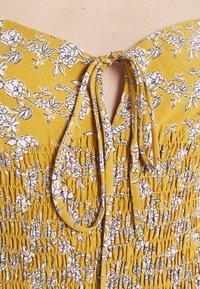 Glamorous - PUFF LONG SLEEVE SMOCKED MINI DRESS - Day dress - ochre - 5