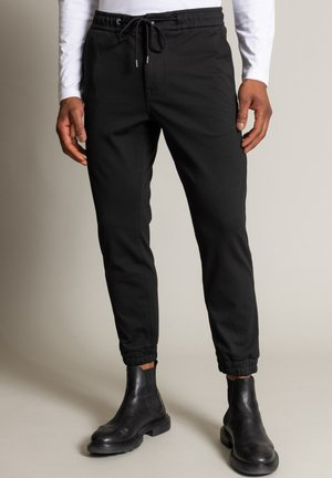 TABER - Trousers - schwarz