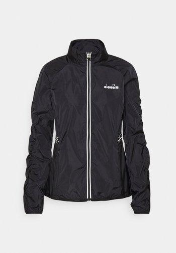 WINDBREAKER JACKET - Sports jacket - black